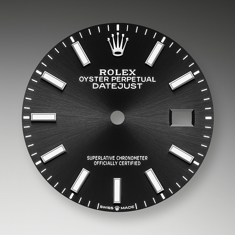 The sunray finish creates delicate light reflections on many dials in the Oyster Perpetual collection. It is obtained using masterful brushing techniques that create grooves running outwards from the centre of the dial. Light is diffused consistently along each engraving, creating a characteristic subtle glow that moves depending on the position of the wrist. Once the sunray finish has been completed, the dial colour is applied using Physical Vapour Deposition or electroplating. A light coat of varnish gives the dial its final look.