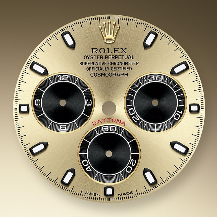 This model's Champagne-colour and blackdial with snailed counters features 18 ct gold applique hour markers and hands in Chromalight, a highly-legible luminescent material.The central sweep seconds hand allows an accurate reading of 1/8 second, while the two counters on the dial display the lapsed time in hours and minutes. Drivers can accurately map out their track times and tactics without fail.