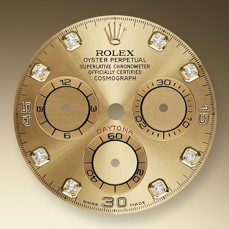 This model's Champagne-color set with diamonds dial with snailed counters features 18 ct gold applique hour markers and hands in Chromalight, a highly-legible luminescent material.