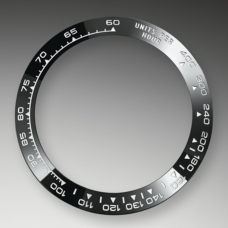 A key part of the model's identity is the bezel molded with a tachymetric scale for measuring average speeds of up to 400 miles or kilometers per hour. Blending of high technology with sleek aesthetics, the black bezel is reminiscent of the 1965 model that was fitted with a black Plexiglas bezel insert.